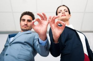 "Man and woman making ""OK"" sign to indicate a high-quality decision-making process"