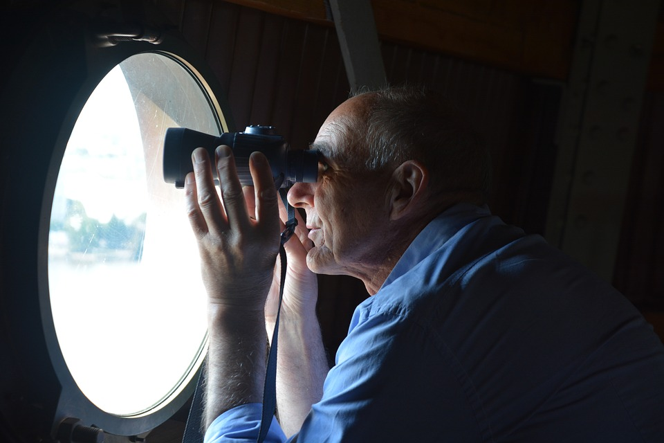 Figure looking out of airplane window representing strategic planning effectiveness