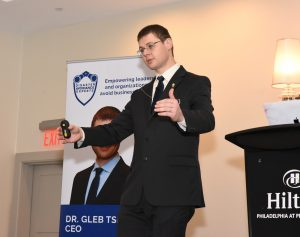 photo of Gleb Tsipursky giving keyone speech at a conference